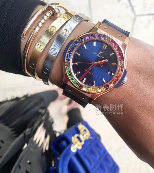 "Rainbow Circle - Rolex Daytona for man, Hublot ""Lady Dubai"" for women"